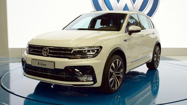 Poznan, Poland - March 31th, 2016: The presentation of Volkswagen Tiguan on the motor show. The second generation of Tiguan was debut in 2015. This model is the most popular SUV from Volkswagen in Europe.