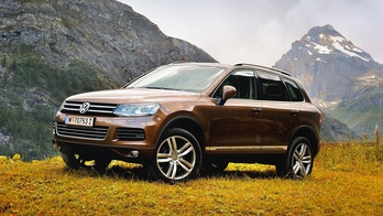 Rhemes Notre Dame, Valle d'Aosta, Italy - July 25, 2016: Volkswagen Touareg ІІ in alps with background view of Granta Parey mountain. Photo captured in the alpine mountains.