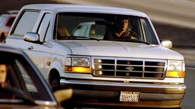 A Ford Bronco carrying OJ Simpson (hidden in rear seat) is reportedly driven by Simpson's former teammate Al Cowlings, chased by dozens of police cars during an hours long pursuit through Los Angeles area freeways, June 17 - RTXFBD5