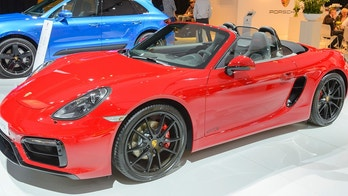Amsterdam, The Netherlands - April 16, 2015: Porsche Boxster GTS roadster sports car on display during the 2015 Amsterdam motor show. People in the background are looking at the cars.