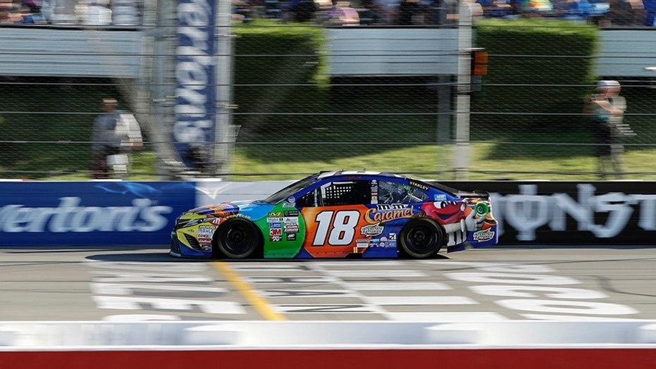 Kyle Busch crosses the finish line to win the NASCAR Cup Series auto race at Pocono Raceway, Sunday, July 30, 2017, in Long Pond, Pa. (AP Photo/Matt Slocum)