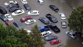 FILE - This Tuesday, Aug. 29, 2017, photo shows flooded cars near the Addicks Reservoir as floodwaters from Harvey rise in Houston. Auto industry experts estimate that 500,000 to 1 million cars, trucks and SUVs were damaged by floodwaters from Hurricane Harvey. Most will have so much water damage that they can't be fixed, and insurance companies will declare them total losses. Yet the damaged cars could be retitled and sold to unsuspecting buyers nationwide. Experts warn against buying the cars because damage could be hidden for years before causing problems. (AP Photo/David J. Phillip, File)