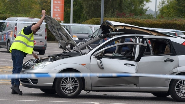 Ford Focus destroyed by an explosion caused by an air freshener outside B&Q Southend on Sea, Essex. See Masons copy MNEXPLODE: A man has been taken to hospital after his car