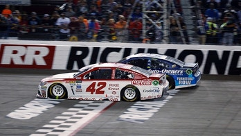 Kyle Larson (42) passes Martin Truex, Jr., (78) on the final restart to win the NASCAR Cup Series auto race at Richmond International Raceway in Richmond, Va., Saturday, Sept. 9, 2017. (AP Photo/Steve Helber)