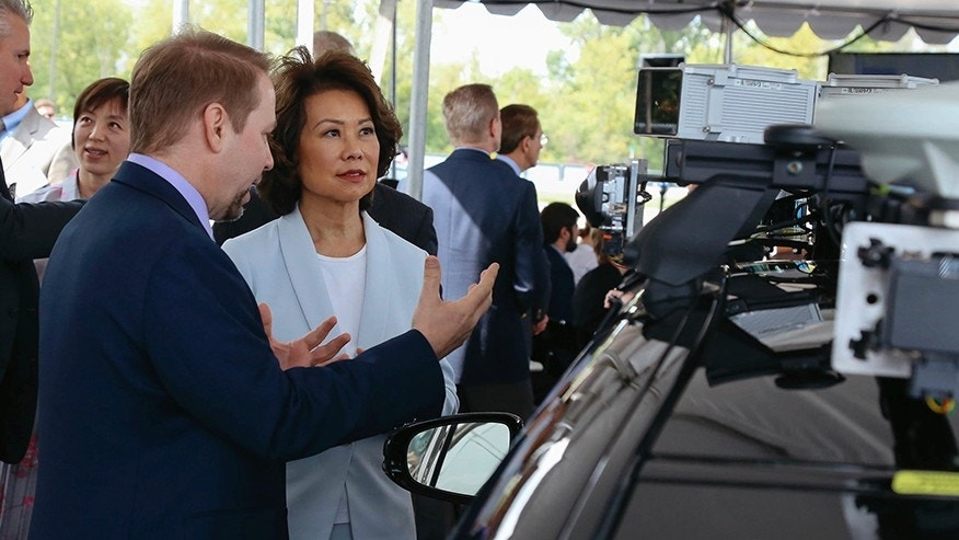 U.S. Transportation Secretary Elaine Chao looks at autonomous vehicle technology after announcing new voluntary safety guidelines for self-driving cars during a visit to an autonomous vehicle testing facility Tuesday Sept. 12 2017 at the University