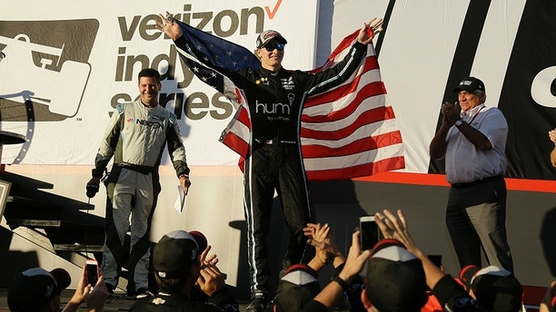 Josef Newgarden celebrates after winning the IndyCar season championship Sunday, Sept. 17, 2017, in Sonoma, Calif. (AP Photo/Eric Risberg)