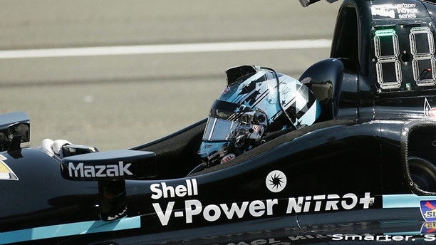 Josef Newgarden sits in his car and waits for a warm up to begin before the start of the IndyCar auto race Sunday, Sept. 17, 2017, in Sonoma, Calif. (AP Photo/Eric Risberg)