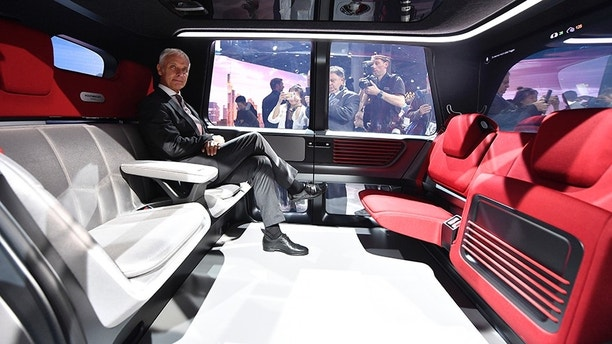 VW CEO Matthias Mueller sits in a Sedric self-driving vehicle during an event of German car maker Volkswagen on the eve of the opening of the International Frankfurt Motor Show IAA in Frankfurt, Germany, Monday, Sept. 11, 2017. From frighteningly fast hypercars to new electric SUVs, the Frankfurt auto show is a major event for car lovers wanting to get a glimpse of the future. (AP Photo/Martin Meissner)