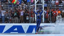 Kyle Busch raises his arms towards fans after winning the NASCAR Cup Series 300 auto race at New Hampshire Motor Speedway in Loudon, N.H., Sunday, Sept. 24, 2017. (AP Photo/Charles Krupa)