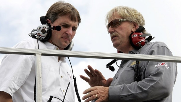 FILE - In this May 25, 2006, file photo, team owner Robert Yates, right, talks with his son Doug Yates, left, during practice for Sunday's NASCAR Nextel Cup Coca-Cola 600 auto race at Lowe's Motor Speedway in Concord, N.C. Robert Yates, a longtime NASCAR owner and engine builder, has died, Doug Yates said on Twitter Monday, Oct. 2, 2017. He was 74. (AP Photo/Terry Renna, File)
