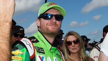 Monster Energy NASCAR Cup Series driver Dale Earnhardt Jr. looks on before a NASCAR Talladega auto race driver introductions at Talladega Superspeedway, Sunday, Oct. 15, 2017, in Talladega, Ala. (AP Photo/Brynn Anderson)