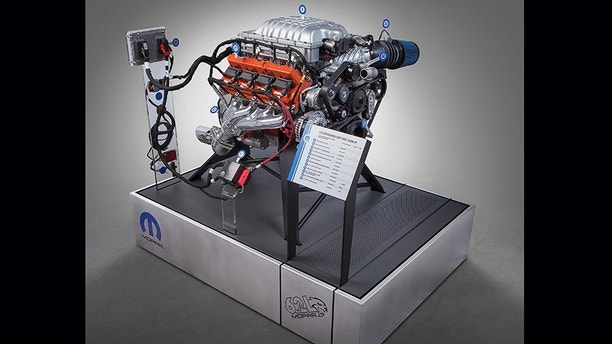 "The Mopar brand is unleashing a new Mopar 6.2L supercharged Crate HEMI® Engine Kit — nicknamed the ""Hellcrate"" — that injects 707 horsepower and 650 lb.ft. of torque under the hood."