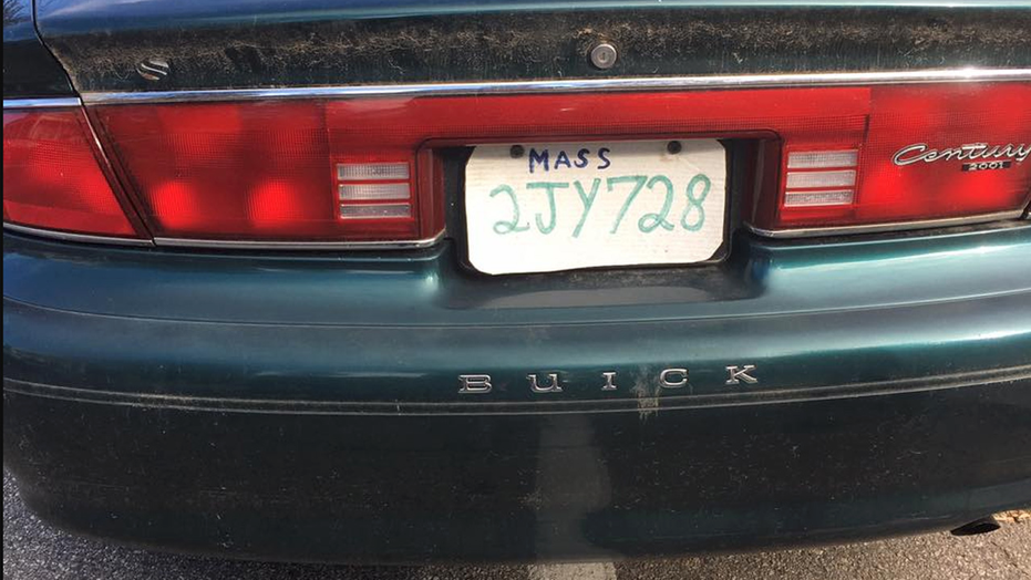 Authorities in Massachusetts stopped a driver who make a license plate out of a pizza box.