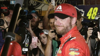 CORRECTS BYLINE TO DARRYL GRAHAM NOT TERRY RENNA Dale Earnhardt Jr. is surrounded upon getting out of his car after a NASCAR Cup Series auto race at Homestead-Miami Speedway in Homestead, Fla., Sunday, Nov. 19, 2017. Earnhardt is retiring from full-time racing. (AP Photo/Darryl Graham)