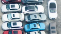 Directly above view of crowded parking lot.