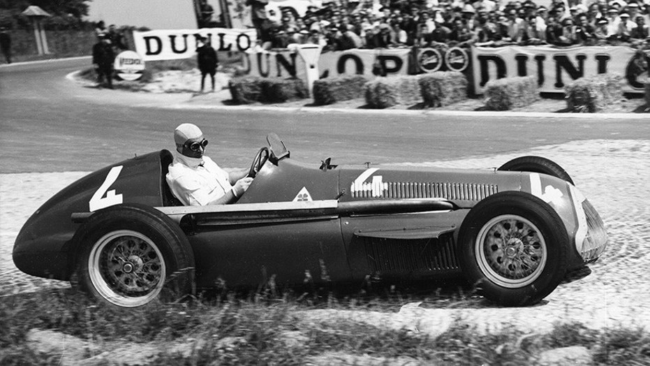 Juan Manuel Fangio at the wheel of an Alfa Romeo at the 1951 Grand Prix D'Europe