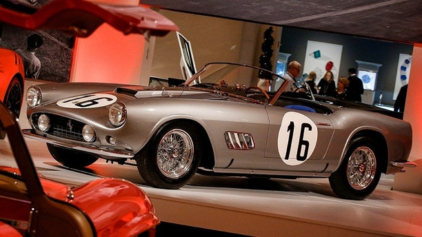 A 1959 Ferrari 250 GT LWB California Spider Competizione by Scaglietti is displayed during a media preview for the 'RM Sotheby's Icons' sale at Sotheby's in New York, U.S., November 30, 2017. REUTERS/Brendan McDermid - RC15999DA9F0