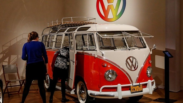 "Guests looks at a 1960 Volkswagen Deluxe ""23-Window"" Microbus displayed during a media preview for the ""RM Sotheby's Icons"" sale at Sotheby's in New York, U.S., November 30, 2017. REUTERS/Brendan McDermid - RC11E8BBA980"