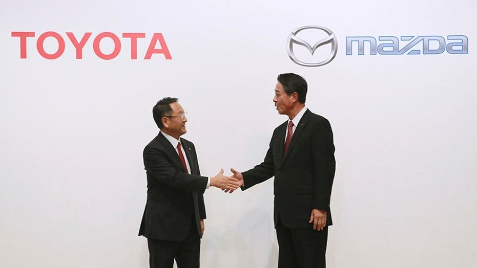 Toyota Motor Corp. President Akio Toyoda and Mazda Motor Corp. President Masamichi Kogai announced plans for a new joint-venture factory in the United States in August 2017.