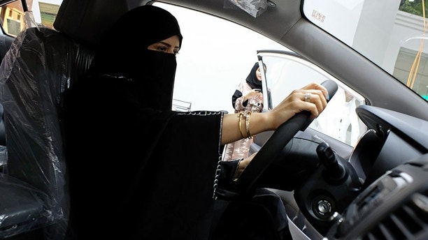 A Saudi woman checks a car  at the first automotive showroom solely dedicated for women in Jeddah, Saudi Arabia January 11, 2018. REUTERS/Reem Baeshen     NO RESALES. NO ARCHIVES - RC119C62ABC0