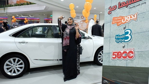 A Saudi woman is seen at the first automotive showroom solely dedicated for women, in Jeddah, Saudi Arabia January 11, 2018. REUTERS/Reem Baeshen     NO RESALES. NO ARCHIVES - RC1946D011C0