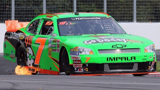 FILE - In this Aug. 17, 2012, file photo, Danica Patrick drives during the morning practice session for the NASCAR Nationwide Series auto race, at the Circuit Gilles Villeneuve in Montreal. Patrick is teaming with Premium Motorsports for next month's Daytona 500, the final race of her NASCAR career. The one-race deal will put Patrick in the seat of the No. 7 GoDaddy Chevrolet, the same car number she drove when she entered stock-car racing in 2010. (AP Photo/The Canadian Press, Tom Boland, File)