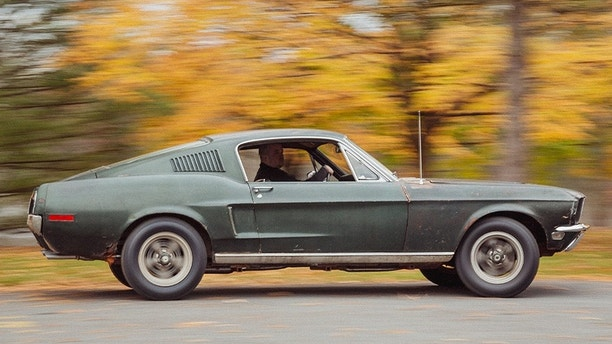 Sean Kiernan driving his original 1968 Mustang that starred in movie Bullitt