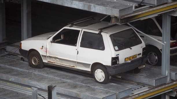 "Cars found trapped in Edinburgh's 'robot car park' 15 years after ""SkyPark"" closed in 2003. Vehicles imprisoned in a disused robotic car park for more than a decade are set to be preserved by demolition crews after work to redevelop the building got underway. Jan 23 2018. See Centre Press story CPCARS; Eight vehicles stuck in a disused robotic car park for more than a decade will be preserved by demolition crews. The £5 million Autosafe ""SkyPark"" was hailed as Britain's ""most technologically advanced car park"" when it opened in Edinburgh in 2001. But the tenure of the car park was short-lived after the company that operated it went into receivership in 2003. It was rumoured at the time that administrators had simply arrived one day to lock the doors, leaving dozens of cars trapped inside. And now, new pictures from a building opposite the site in the centre of Edinburgh show a ""time capsule"" with vehicles which look to be models from the late 1990s."