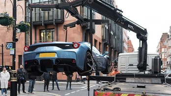 "This is the moment cops in London seized a limited edition Ferrari worth half a million pounds - because its young owner didn't have car insurance. See SWNS story SWFERRARI; Stunned onlookers in posh Mayfair watched the bizarre scene unfold on Sunday afternoon as the Ferrari 458 Speciale Aperta, one of only 499 ever made, was lifted onto a towing truck. Cops said the driver was reported on suspicion of using the expensive car, which is even more sought-after because it is one of the few with a right-hand drive, without insurance. An eyewitness said:""The young man was in a baby blue Ferrari worth probably around £600,000.""He was driving in convoy through Mayfair with his dad who was in a Porsche 918."""