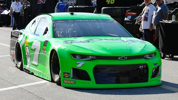 Danica Patrick drives back to her garage after NASCAR auto racing practice at Daytona International Speedway, Saturday, Feb. 10, 2018, in Daytona Beach, Fla. (AP Photo/Terry Renna)