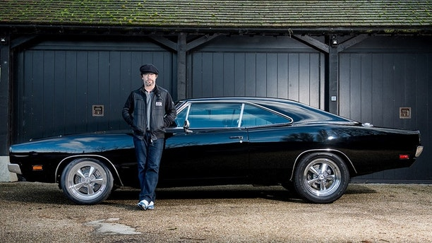 Jay Cay and fis fully restored 1969 Bullitt Dodge Charger