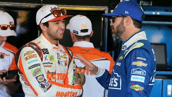 FILE - In this Nov. 10, 2017, file photo, Chase Elliott, left, and Jimmie Johnson talk inside the garage area before practice for the NASCAR Cup Series auto race at Phoenix International Raceway, in Avondale, Ariz. Hendrick Motorsports still has seven-time champion Jimmie Johnson in the stable, as well as budding star Chase Elliott. (AP Photo/Ralph Freso, File)