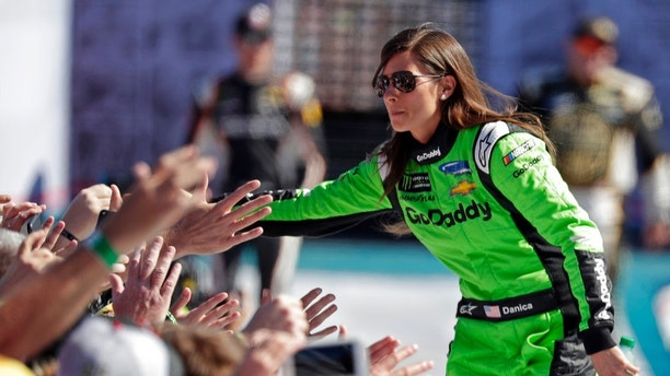Danica Patrick greets fans as she is introduced before the NASCAR Daytona 500 Cup series auto race at Daytona International Speedway in Daytona Beach, Fla., Sunday, Feb. 18, 2018. (AP Photo/John Raoux)