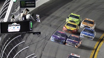 Austin Dillon (3) takes the checkered flag to win the NASCAR Daytona 500 Cup series auto race at Daytona International Speedway in Daytona Beach, Fla., Sunday, Feb. 18, 2018. (AP Photo/David Graham)