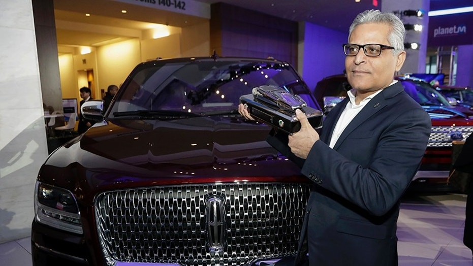 Kumar Galhotra with the 2018 North American Truck of the Year award for the Lincoln Navigator.