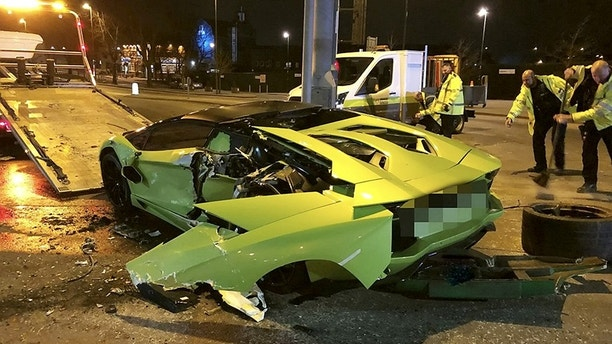 "The wreckage of a green Lamborghini following a crash with a bus in Carrington Street, Nottingham. See NTI story NTILAMBO. A Nottinghamshire Police spokesman said: ""We were called at around 9.10pm (25/2) to reports of a collision between a car and a bus that happened in Carrington Street."
