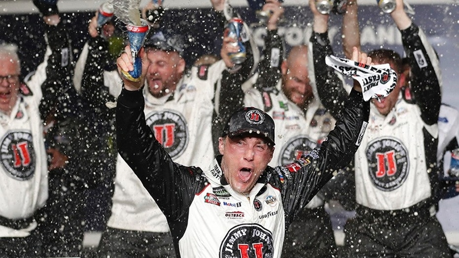 Kevin Harvick celebrates with his team in victory lane.