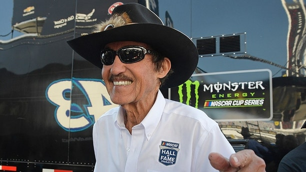 Richard Petty smiles as he signs autographs during practice for the NASCAR Daytona 500 Cup Series auto race at Daytona International Speedway in Daytona Beach, Fla., Saturday, Feb. 17, 2018. (AP Photo/Phelan M. Ebenhack)
