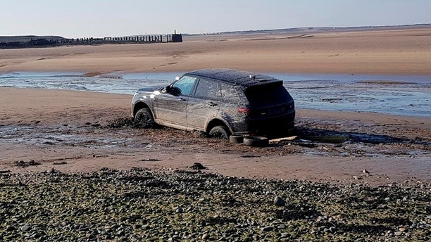 "Conservationists have slammed the group of trespassers who got a brand-new Range Rover worth £100,000 stuck in the sand at a protected beach. See SWNS story SWSTUCK; South Walney Nature Reserve, which is run by the Cumbria Wildlife Trust, is a Site of Special Scientific Interest, a Special Area of Conservation and a Special Protection Area. Parts of the beach are illegal to walk on - and there are clear signs warning motorists about driving on it. But this didn't stop a group of three trespassers from the Midlands who took a detour to the Cumbrian coastline on Sunday during a trip to Scotland. The men took the brand-new rental Range Rover, which was registered less than a fortnight ago, on the beach and got stuck. The joy ride has caused damage to the protected sands while also causing serious problems for the luxury 4x4, which had to be towed out by a tractor. Sarah Dalrymple, South Walney warden, said: ""It is illegal, dangerous and damaging to take cars onto the sands."