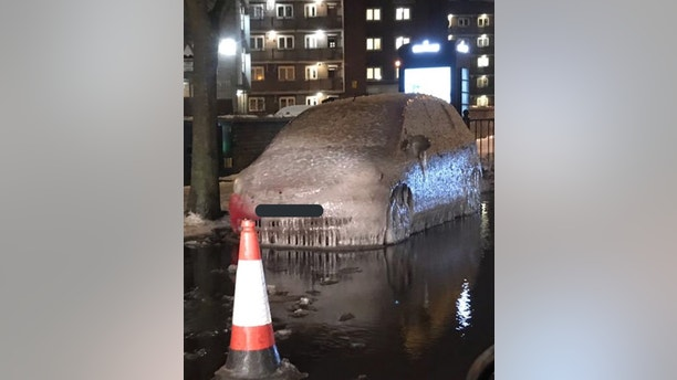 """This Londoner won't be able to drive to work today (Fri) - because their car was trapped in a block of ICE. See National story NNICE; The frozen motor was left unidentifiable after being turned into a block of ice by a burst water pipe. Workers were scrambled this morning to repair the pipe, but the car, in Tower Hamlets, east London, is unlikely to get thawed for a few days. Tower Hamlets Police offered their """"deepest sympathy"""" to the driver on Twitter. Traffic wardens will struggle to ticket the car, which has been stuck for two days. Twitter user @baoigheallain said: """"The lengths some owners will go to to prevent a parking officer sticking a ticket to their windscreens."""""""