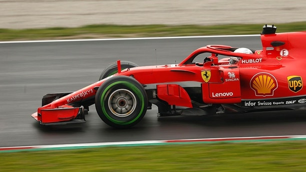 Ferrari driver Sebastian Vettel of Germany steers his car during a Formula One pre-season testing session at the Catalunya racetrack in Montmelo, outside Barcelona, Spain, Thursday, March 1, 2018. (AP Photo/Francisco Seco)