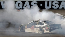 Kevin Harvick performs a burnout after winning a NASCAR Cup series auto race Sunday, March 4, 2018, in Las Vegas. (AP Photo/Isaac Brekken)