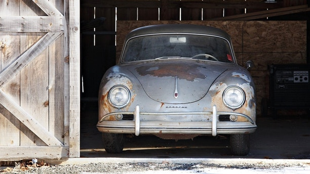 Porsche 356A 1500 GS Carrera Coupe that is up for sale. See SWNS story SWPORSCHE; A rusty old Porsche which doesn't work is set to sell for £500,000 after being described as one of the most exciting discoveries in recent years. The Porsche 356A 1500 GS Carrera Coupe helped bridge the gap between the company's sports vehicles and racing cars when it debuted in 1955. But this 1957 model hasn't been driven for 45 years after its brakes failed a safety inspection in the early 1970s. Its original engine was removed and taken apart and, after the best part of half-a-century of neglect, the bodywork and wheels are covered in rust.