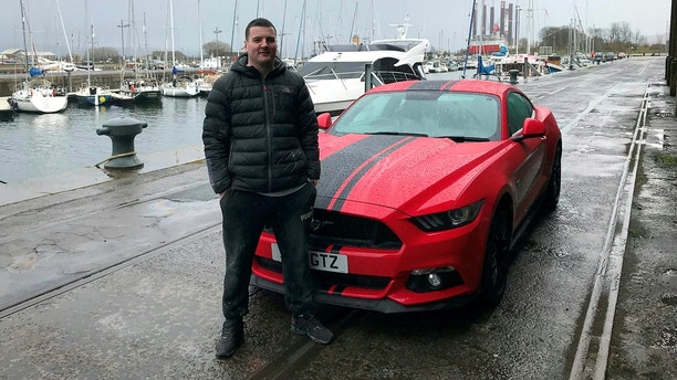 """Andy Quay, drove a quad bike into his brand new sports car worth nearly £50,000. See SWNS story SWQUAD; This was the shocking moment a man drove a quad bike into his brand new sports car worth nearly £50,000. Andy Quay, 25, was trying to park the quad bike, which belongs to a pal, beside his red Ford Mustang GT500, which he bought less than a year ago. But as he took his foot off the pedal, the bike accelerated forward and smashed into the side of the sports car before spinning in the air, throwing Andy off. Andy said: """"It just took off and did a wheelie, knocking off the wing mirror of my car."""