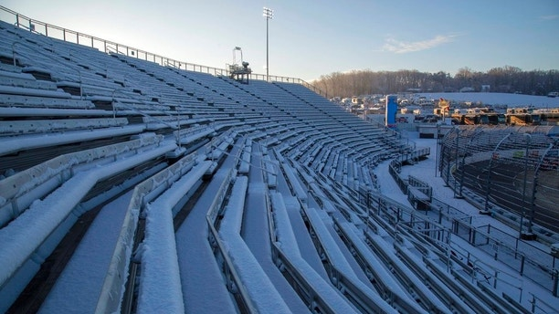 Snow covers seats at Martinsville Speedway in Martinsville, Va., Sunday, March 25, 2018. The NASCAR Cup Series race at Martinsville Speedway was postponed until Monday because of inclement weather. (AP Photo/Matt Bell)