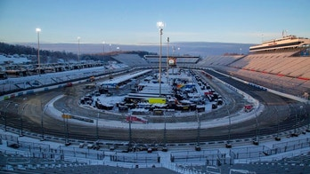 Snow rests on the ground at Martinsville Speedway in Martinsville, Va., Sunday, March 25, 2018. The NASCAR Cup Series race at Martinsville Speedway was postponed until Monday because of inclement weather. (AP Photo/Matt Bell)