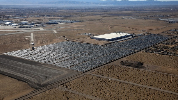 Reacquired Volkswagen and Audi diesel cars sit in a desert graveyard near Victorville, California, U.S. March 28, 2018. Volkswagen AG has paid more than $7.4 billion to buy back about 350,000 vehicles, the automaker said in a recent court filing, and is now storing thousands of vehicles around the United States. Picture taken March 28, 2018.  REUTERS/Lucy Nicholson - RC14AC0F08A0