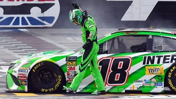 Kyle Busch (18) celebrates after winning a NASCAR Cup Series auto race in Fort Worth, Texas, Sunday, April 8, 2018. (AP Photo/Larry Papke)