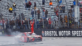 Kyle Busch celebrates after winning during a NASCAR Cup Series auto race, Monday, April 16, 2018 in Bristol, Tenn. (AP Photo/Wade Payne)