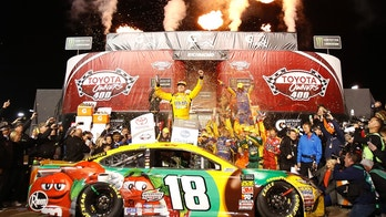 Kyle Busch, center, celebrates in Victory Lane after winning the NASCAR Cup Series auto race at Richmond Raceway in Richmond, Va., Saturday, April 21, 2018. (AP Photo/Steve Helber)